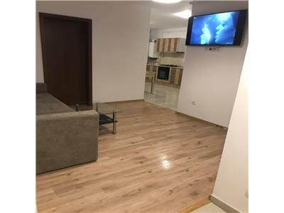 PRET SPECIAL! Apartament trei camere bloc nou etaj intermediar garaj in zona strazii Calea Turzii!